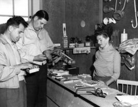 Evergreen Park Resort [showing visitors examine merchandise at sporting goods shop]