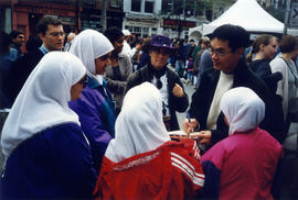 Paul Yee signing books at Word on the street festival, Toronto