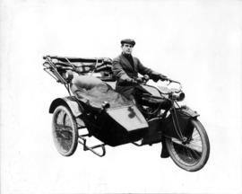 [Alfred T. Layne, actor, on a motorcycle with sidecar]