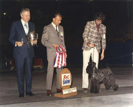 T.R. Fyfe and judge presenting Best in Show award at 1973 P.N.E. All-Breed Dog Show [Kerry Blue T...