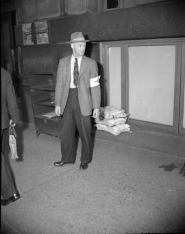 [Union security man during a strike at the Daily Province]