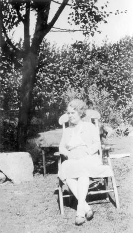 [Emily Matthews in chair in 1158 Arbutus Street garden]