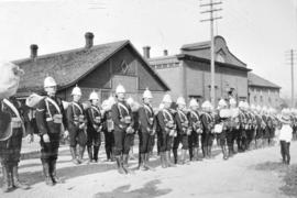 """Attention"" [Yukon contingent of Canadian soldiers in front of drill hall on Pender Str..."