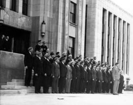 [City Hall staff who served in World War I outside City Hall during visit of King George VI and Q...