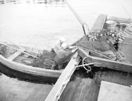 [Loading fish net onto a row boat] Prince Rupert (B.C.)
