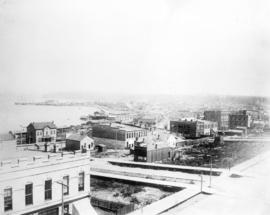 [View of buildings near waterfront, looking east from Hastings and Seymour Streets]