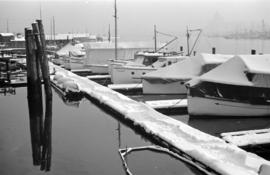 [Boats and dock covered with snow]