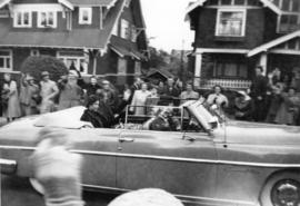 Princess Elizabeth and Philip, Duke of Edinburgh, travelling in a convertible in Kitsilano