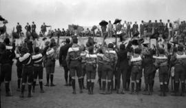 [Scouts waving hats at a scout rally with General Baden-Powell, Hastings Park]