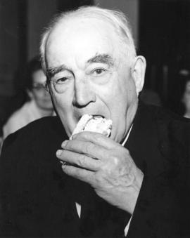 [Major J.S. Matthews eats cake to celebrate the 50th Anniversary of the Imperial Bank of Canada B...