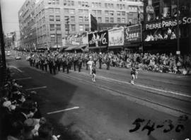 Majorettes and marching band in 1954 P.N.E. Opening Day Parade