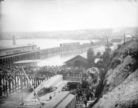 [Crowds at C.P.R. station viewing the arrival of the] first train in Vancouver