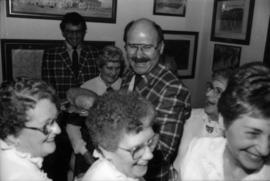 Michael Francis and Mike Harcourt with a group of women