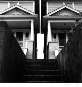 Steps and front facades of houses at 357 and 363 Cordova Street