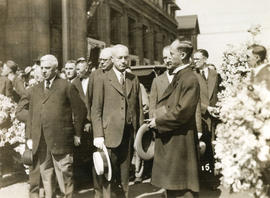 [Pastor Kwan and other men standing in front of church after Yip Sang funeral service]