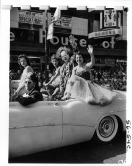Gizeh Temple Shriner and P.N.E. Shrine Circus performers in car during 1956 P.N.E. Opening Day Pa...