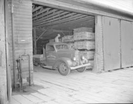 [Evans, Coleman and Evans delivery truck being loaded in a warehouse]