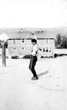 Board of Trade - Williams Lake - [Young man demonstrating a lasso]