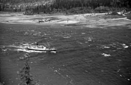 [View of a ferry in the choppy waters of Burrard Inlet near the delta of the Capilano River]