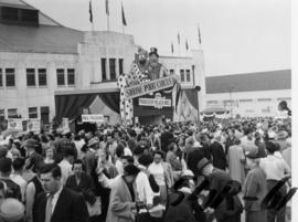 Crowd by entrance to Shrine P.N.E. Circus, Forum building