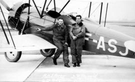 R.H. Storer and B.R. Ronald in front of bi-plane used in Trans-Canada flight