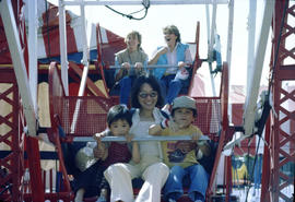 Woman and two children riding the ferris wheel