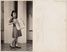 Young woman playing accordion