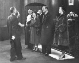 [Alderman and Mrs. A.W. Fisher greet H.R.H. Princess Elizabeth and H.R.H. Philip Duke of Edinburgh]