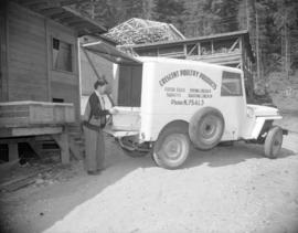 [Woman loading eggs into a Crescent Poultry Products delivery jeep]