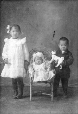 [Three unidentified children]