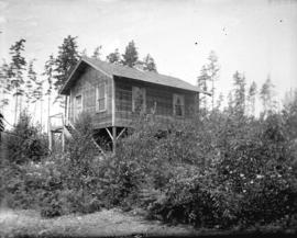 [House at 3356 East 44th Avenue surrounded by trees and bushes]