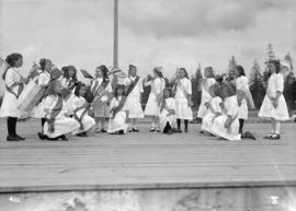 6th Field Company C.E. [?girls on outdoor stage with flags]
