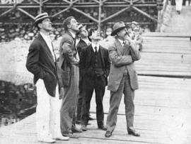 [L.D. Taylor and four young men standing on dock looking upwards]