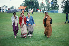 Four women walking across field during the Centennial Commission's Canada Day celebrations
