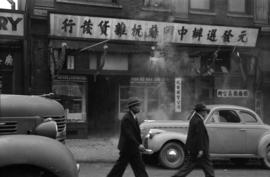 [Yuen Fat Wah Jung Company store front during VJ Day celebrations]