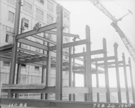 Construction of pan house: erecting steel, 2nd tier scaffold for building gallery across back of ...