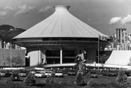Centennial Museum and Planetarium complex with mountains in background