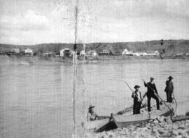 [Four men in canoes across the Fraser River from Quesnell]
