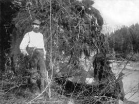[Men standing in woods near Coquitlam Dam site]