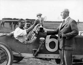 Awarding of trophy to automobile racers