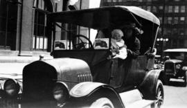 Audrey Gowe and her mother, Flora in front of CPR station on Dominion Day, first car, 1925