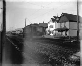 [View of 1000 block of Robson Street, showing streetcar and James Stark residence]