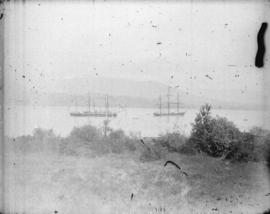 [View of clearing at foot of Burrard Street, showing ships in harbour]