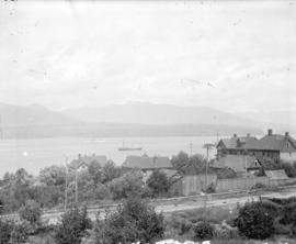 [View of Pender Street between Burrard and Thurlow Streets, showing ships in harbour]