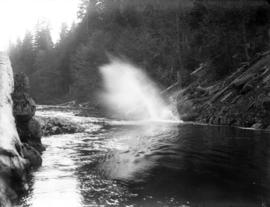 [Log falling into Seymour River from chute]