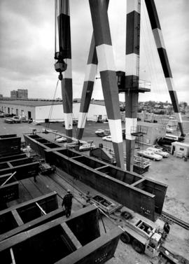 Unloading curved steel beams at Centennial Pier