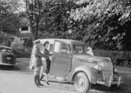 Truck and wedding couple, Matthews Avenue, International Harvester [Co. of Can. Ltd. of 1135 Seym...