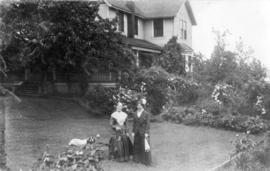 [Mrs. Maddam and Mary in yard of residence - 941 East 7th Avenue]