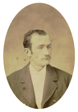 [Head and shoulders studio portrait of man]
