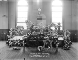 Casket [with wreaths and flowers] of late G.J. Kelly, President of I.L.A. [International Longshor...